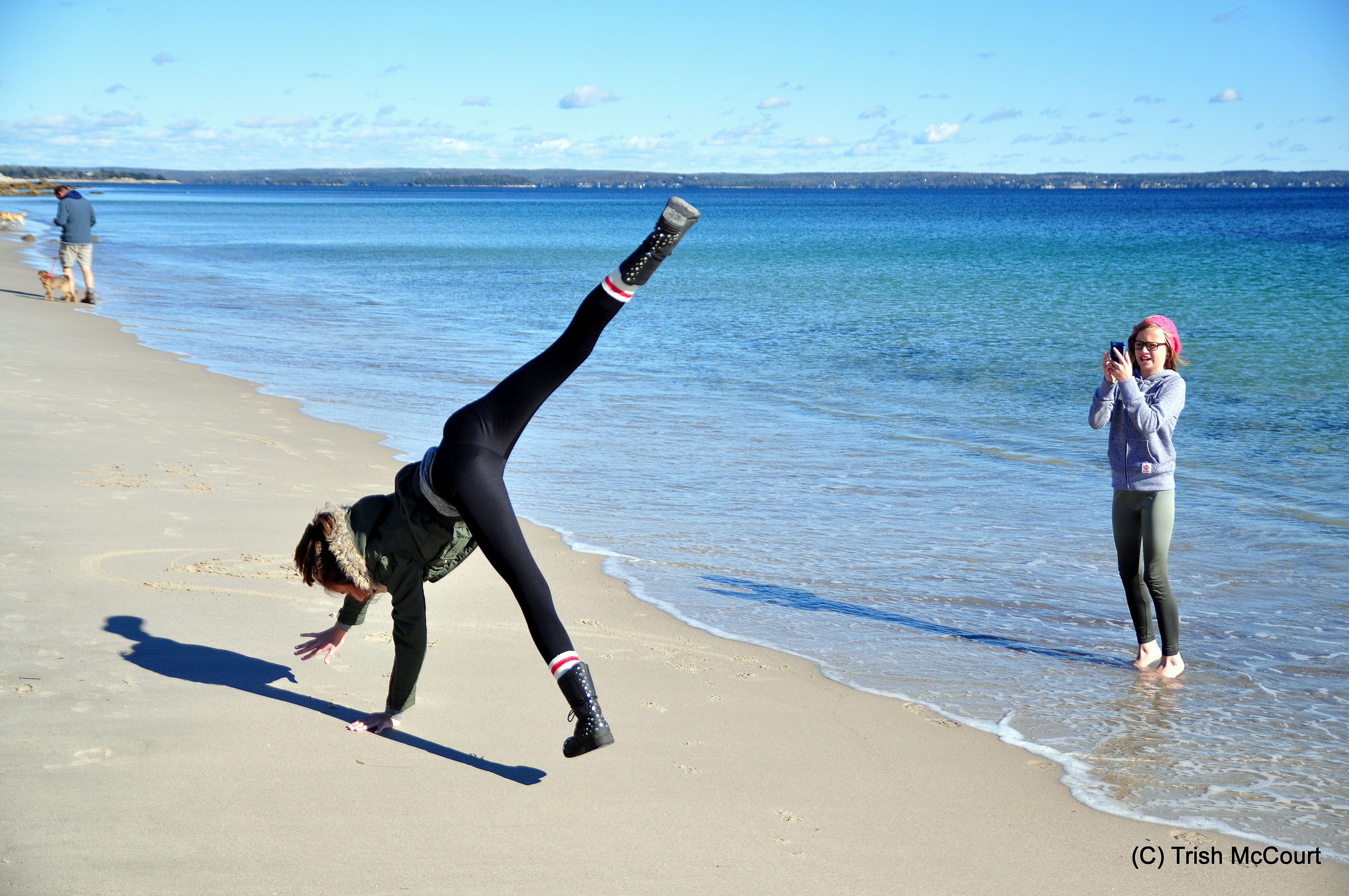 Leaping on the beach